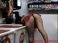 Flashing Latina Grocer