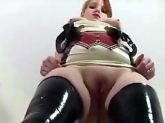 Chatty redhead in an amazing latex outfit