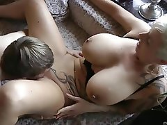 Tattoo Milf Taking On A Young Boy