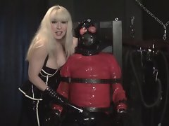 Rubber Bondage Slave plugged gagged and vibrated by Madame C